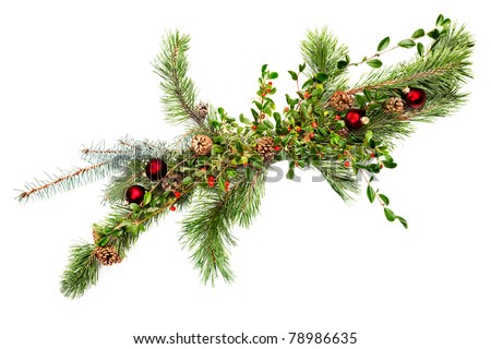 Holiday garland with ornaments, pine & spruce branches, pine cones and evergreen with berries (Common Bearberry/Kinnikinnick). Shot straight down but at an angle to get maximum length in frame.
