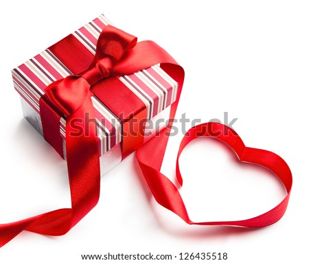 holiday gift box with red ribbon in the shape of a heart isolated on white background