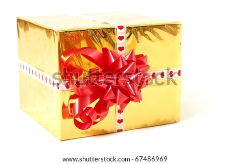 holiday gift in box with gold foil and red bow isolated on white background