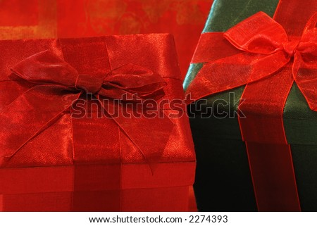 Holiday Gifts - Pretty gifts in fabric covered boxes with gossamer ribbons and bows for a special person.