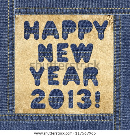Holiday greeting - Happy New Year 2013! - made of denim letters in jeans frame on a leather label - stock photo