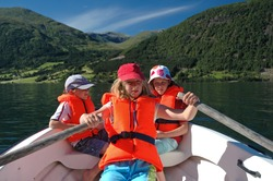 holiday image of children in row boat