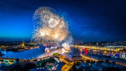 Holiday in Petersburg. Panoramic view from the city SAINT-PETERSBURG. Fireworks over Petersburg. Holidays in Russia. Scarlet Sails. Petersburg during the white nights. A sailboat with scarlet sails.
