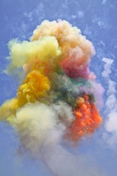 Holiday in the colorful explosion of smoke in the air