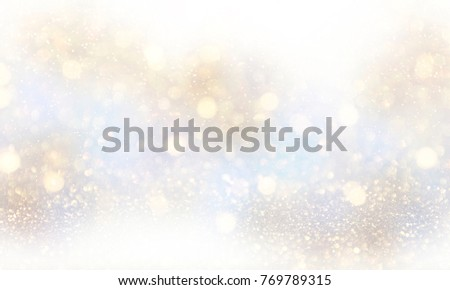 Holiday light background.  Christmas and New Year holidays glowing backdrop. Defocused Background With Blinking Stars. Blurred Bokeh.