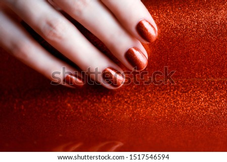 Holiday manicure. Shiny red manicure on a shiny red background. #1517546594