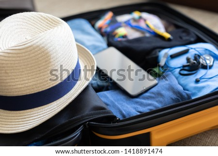 holiday preparations, things put in the suitcase, bag