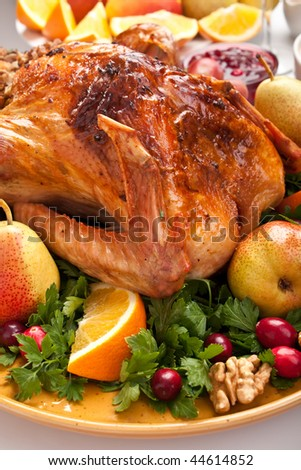 holiday roasted turkey garnished with sourdough stuffing and fruit