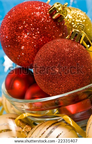 Holiday series: christmas red and golden ball in bowl