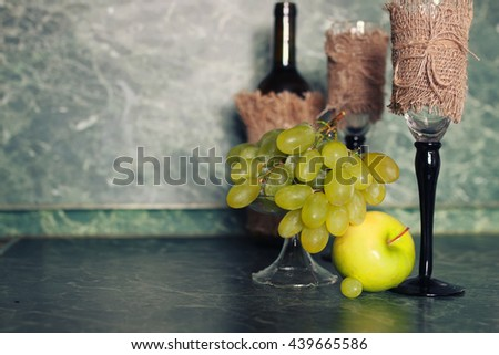 holiday set wine bottle with green grape on background #439665586