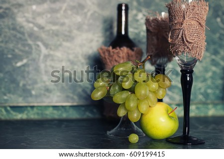 holiday set wine bottle with green grape on background #609199415
