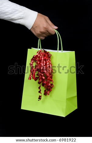 Holiday shopping bag with red bow waiting to be filled with gifts and goodies