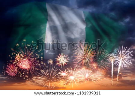 Holiday sky with fireworks and flag of Nigeria, independence day #1181939011