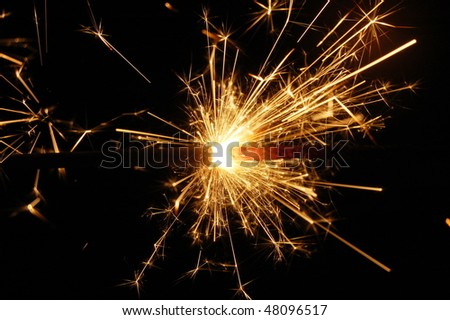 holiday sparkler isolated on black background with copyspace - stock photo