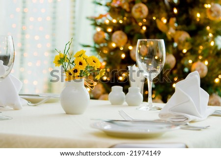 holiday table against christmas background, new year dining