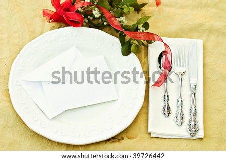 Holiday Table Setting with blank card and mistletoe.