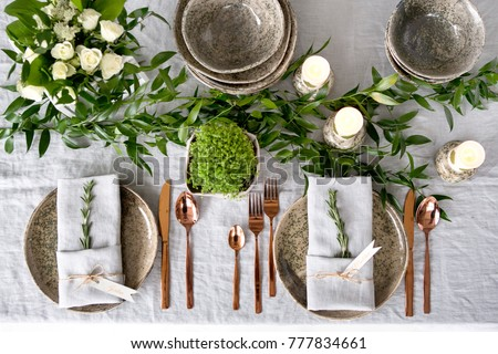 Holiday table setting with Linen napkins and rose gold cutlery. Close up Foto d'archivio ©