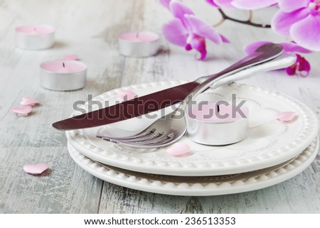 holiday table valentines day. dishes, candles and flowers. holidays & events. selective focus