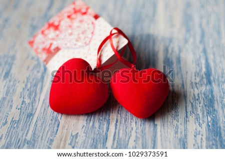 Holiday Valentine's Day, background with space for copy. Valentine and red hearts on a wooden background