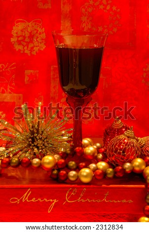 Holiday Wine - A glass of merlot wine sits among the holiday decorations.