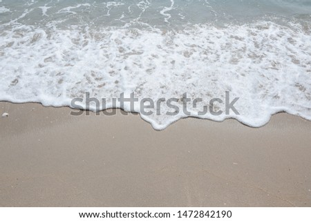 Holiday with Soft wave,Soft wave with foam of ocean on the sandy beach,Sea wave,Soft wave bubble #1472842190