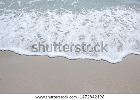 Holiday with Soft wave,Soft wave with foam of ocean on the sandy beach,Sea wave,Soft wave bubble #1472842196