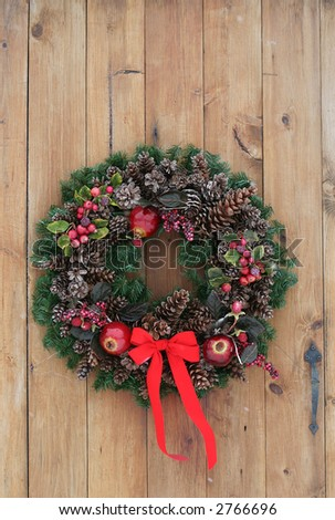 holiday wreath on pine door
