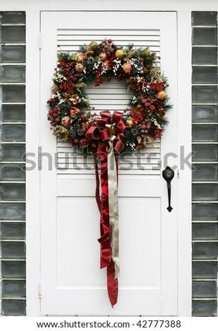 holiday wreath on white door