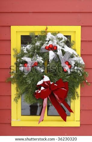 holiday wreath on window - stock photo