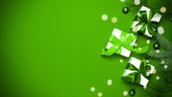 Holiday xmas background. White gifts with emerald bow, green balls and sparkling lights in Christmas decoration on greenish background for greeting card. Winter festive composition with copy space.