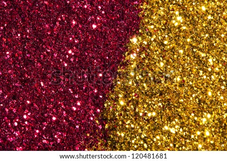 Holiday yellow and red shiny background. Shiny particles in yellow and red colors