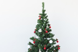Holidays and celebration concept - Decorated Christmas tree on white background with copy space.