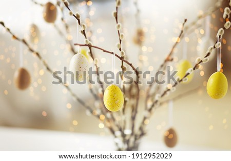 holidays and object concept - close up of pussy willow branches decorated by easter eggs over bokeh lights Stock fotó ©