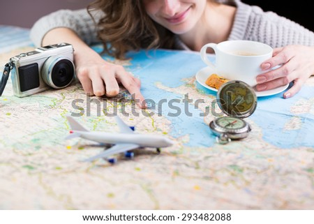 holidays and tourism concept. Coffee break for the dream of travel. Shallow depth of field