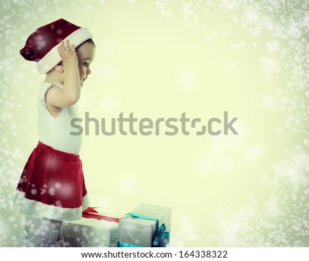 Holidays, baby girl with presents, christmas, birthday, new year, x-mas concept - happy child girl with gift boxes, toned