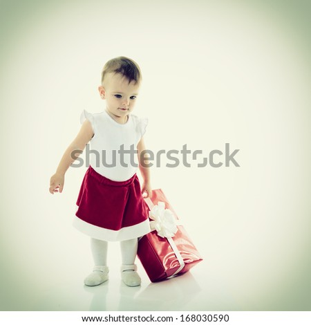 Holidays, baby girl with presents, christmas, birthday, new year, x-mas concept - happy child girl with gift boxes