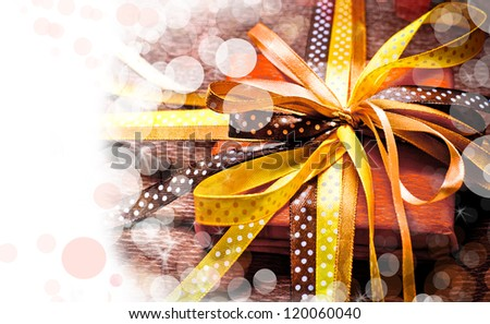 Holidays background/ Holidays present with bow from atlas ribbon/ Romantic holidays gift