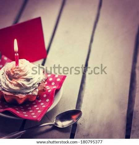Holidays background with Birthday cupcake/ Birthday greeting card with cupcake and candle