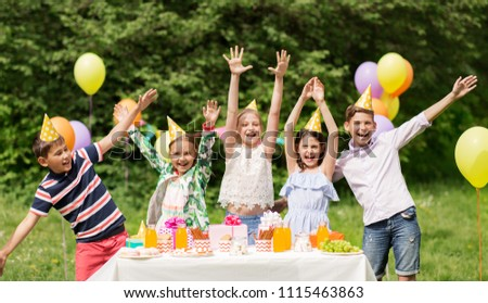 holidays, childhood and celebration concept - happy kids hugging on birthday party at summer garden #1115463863