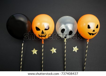 holidays, decoration and party concept - air balloons for halloween over black background.Top view #737408437