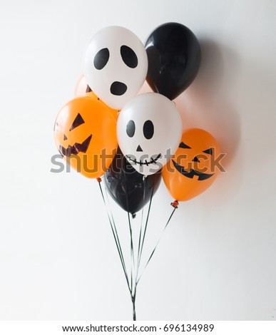 holidays, decoration and party concept - bunch of scary air balloons for halloween over white background #696134989