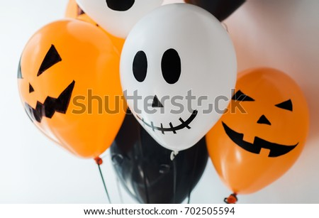 holidays, decoration and party concept - bunch of scary air balloons for halloween over white background #702505594