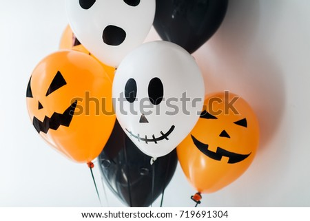 holidays, decoration and party concept - bunch of scary air balloons for halloween over white background #719691304