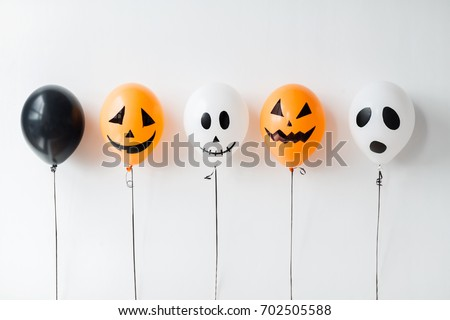 holidays, decoration and party concept - scary air balloons for halloween over white background stock photo