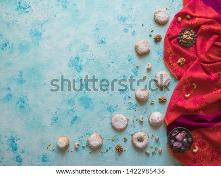Holidays food background. Arab sweets are laid out on a blue table. #1422985436