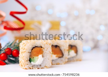 Holidays Food. Christmas sushi. New Year sushi. Postcard for restaurant and cafe. Christmas card with sushi. Card for web. Beautiful tasty food. Holidays mood. Real sushi. Healfy food. Seafood.