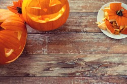 holidays, halloween and decoration concept - close up of pumpkins on table with copy space
