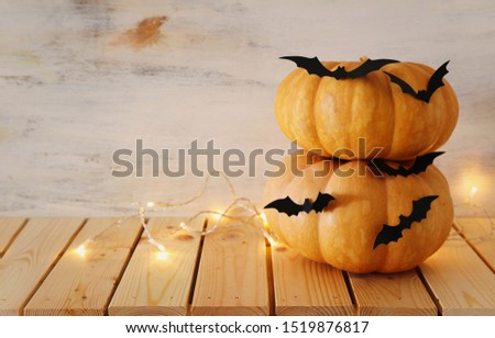 holidays Halloween image. pumpkins and bats over wooden white table