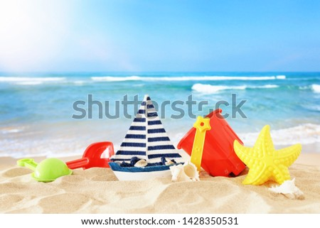 holidays. vacation and summer image with beach colorful toys for kid over the sand #1428350531