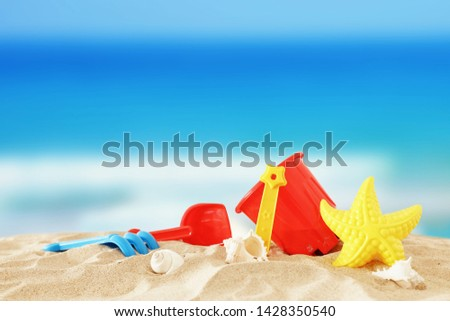 holidays. vacation and summer image with beach colorful toys for kid over the sand #1428350540